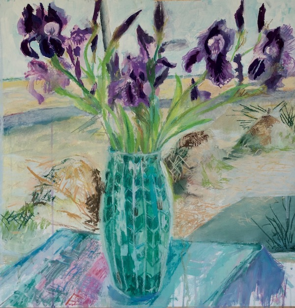 Irises in a tall green vase