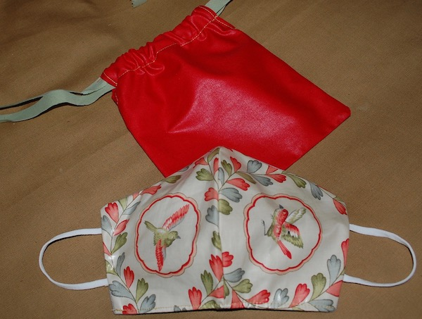 bird mask and red bag