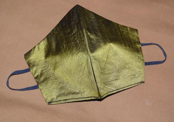 Green silk face mask