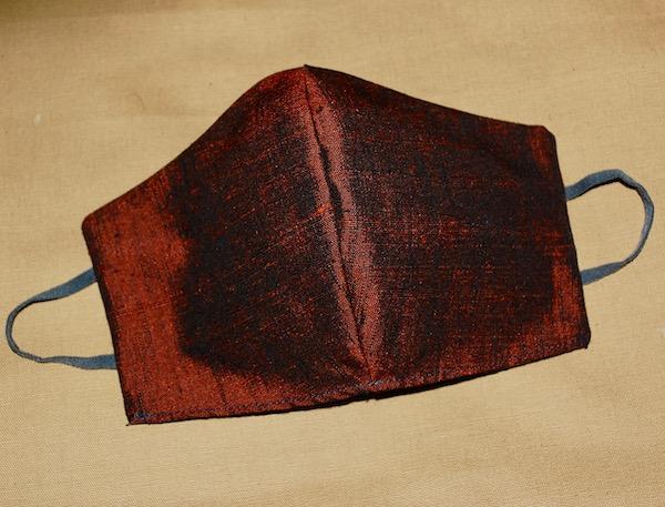orange/black shot silk mask